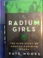 The Radium Girls: The Dark Story of America's Shining Women, by Kate Moore, superimposed on the cover of Intermediate Physics for Medicine and Biology