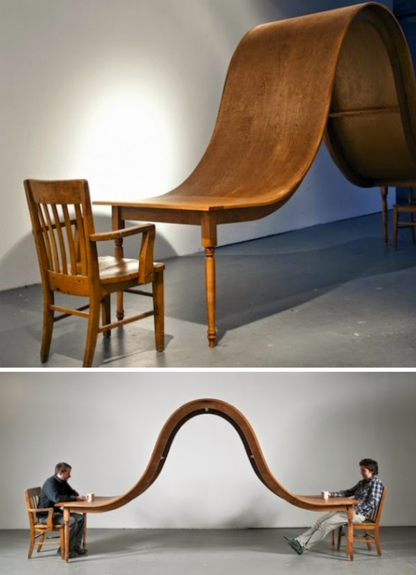 ... that starts out as a regular old table and shoots up to completely  block out the view of the person across the way. [Link, Designer - Michael  Beitz]