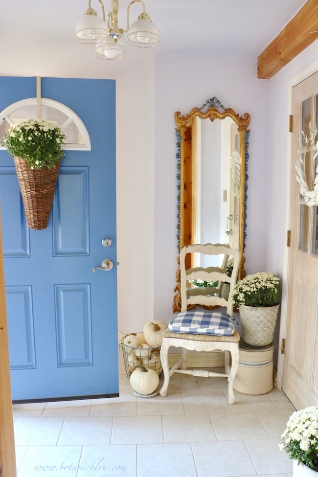 Fall blue and white cottage style small foyer connects house to garage