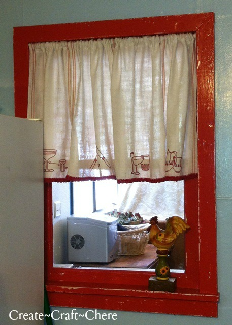 Retro kitchen makeover distressed red window and redwork embroidery tea towel curtains and crocheted lace trim