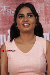 Actress Srushti Dange Stills in Short Dress at Mupparimanam Press Meet  0016.jpg