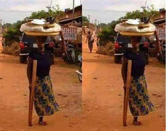 woman one leg selling streets