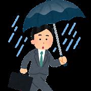 雨の日に外回りをする男性会社員のイラスト