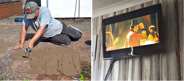 My fella cementing the floor and The Greatest Showman on the TV