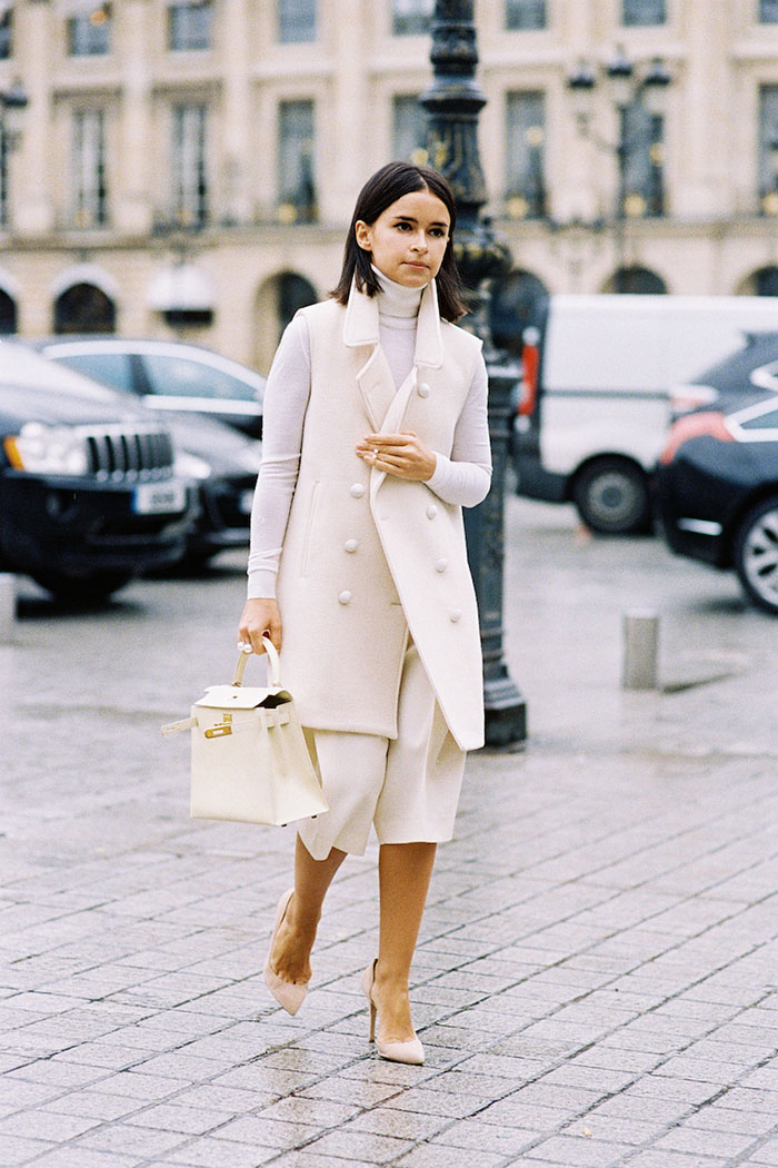 Miroslava Duma keeps it simple as she crosses the street in a chic all white ane neutral color palette