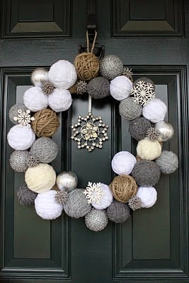 amazing wreath with knitted balls and paper snowflake