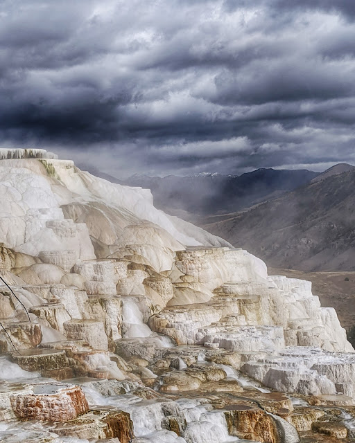 Adventurous Tastes| White travertine formations at Mammoth Hot Springs in Yellowstone