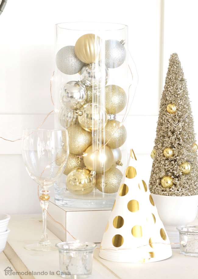 Christmas ball ornaments in glass jar, gold tinsel tree and gold polka dot hats