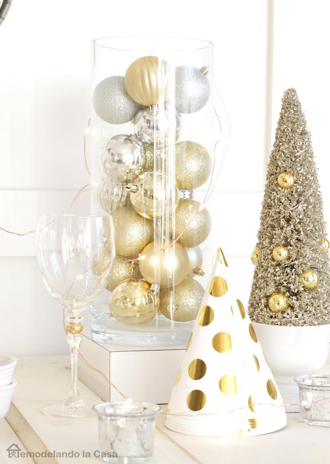 Christmas ball ornaments in glass jar, gold tinsel tree and gold polka dot hats