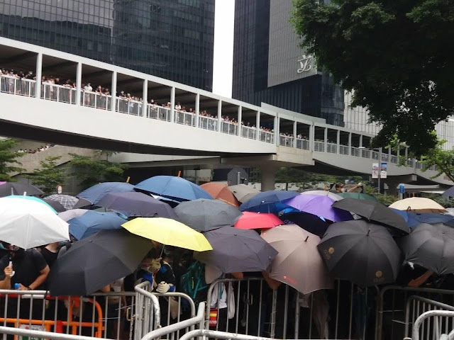 people protesting proposed extradition law in Hong Kong