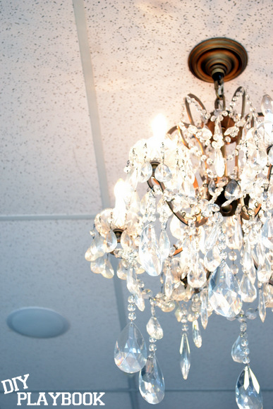 An Antique chandelier gave so much simple elegance to the salon design