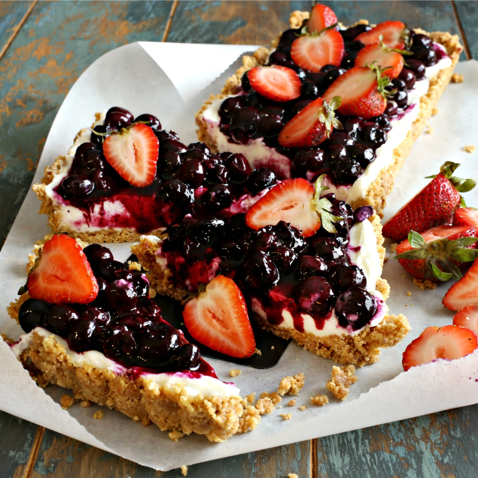 Recipe for a no-bake cheesecake made with Greek yogurt, a graham cracker crust and a blueberry compote topping.