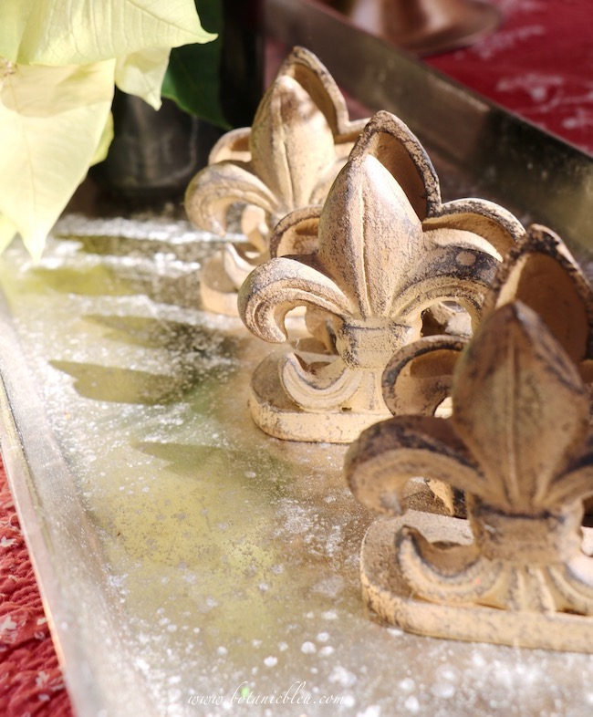 Metal fleur de lis card holders are destined to hold name place cards in the French Country Christmas greenhouse