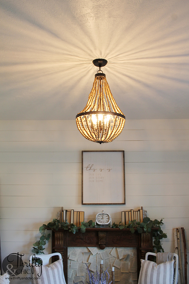 Beaded chandelier. World Market beaded chandelier. Neutral living room decor and decorating ideas. Farmhouse living room decor. Living room chandelier ideas. Board and batten and shiplap walls. cottage living room decor. White living room decor. Boho style living room decor.