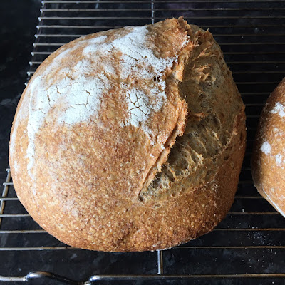 A round loaf with an open score line