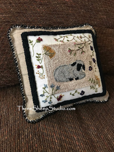 'Spring Lamb' punch needle embroidery by Rose Clay. Punch Needle design uses Valdani variegated Perle, Rustic Wool Moire Thread and is embellished with Hand Embroidery