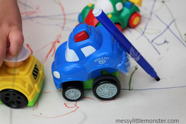 toddler drawing with cars