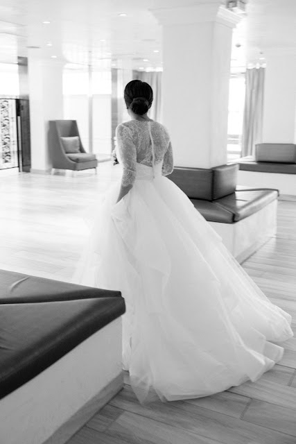The delicate lace back of Jin's wedding gown before her Bridgeview Yacht Club