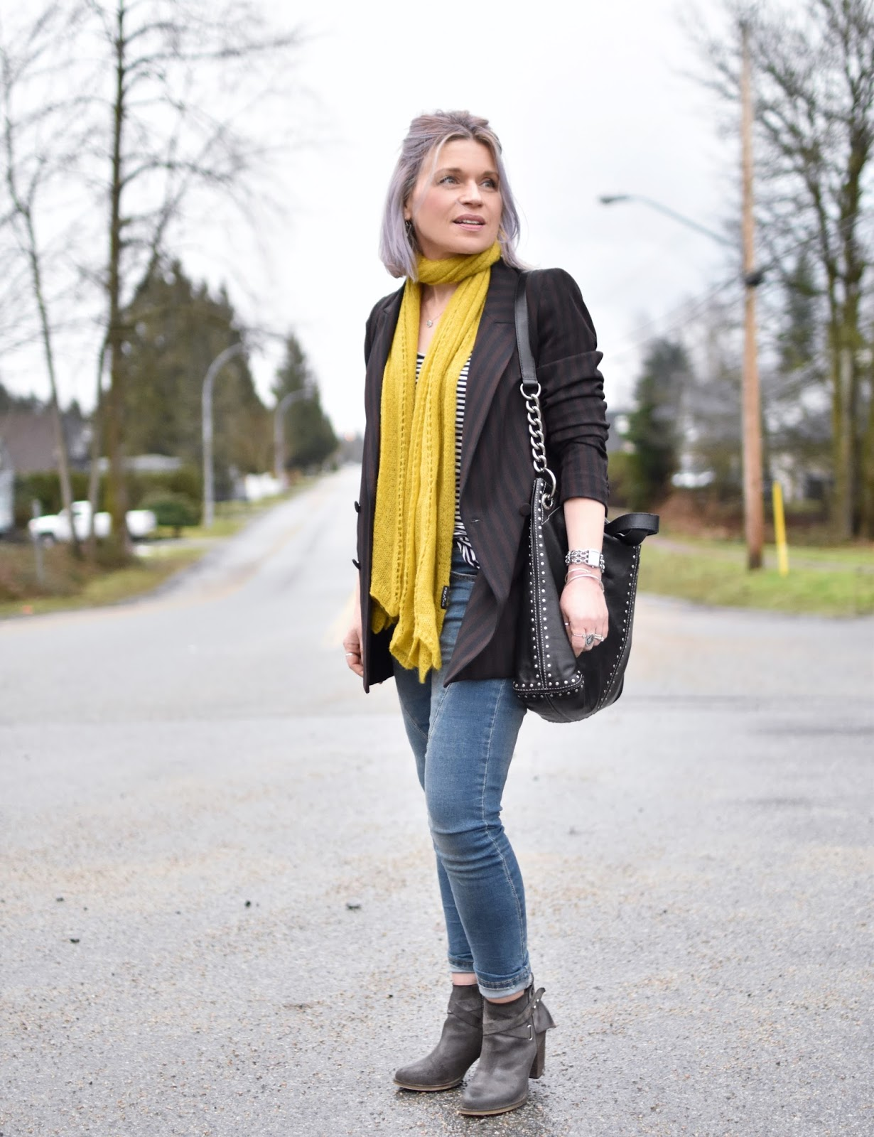 Monika Faulkner outfit inspiration - styling a double-breasted suit jacket with a striped tee, skinny jeans, mustard scarf, and booties