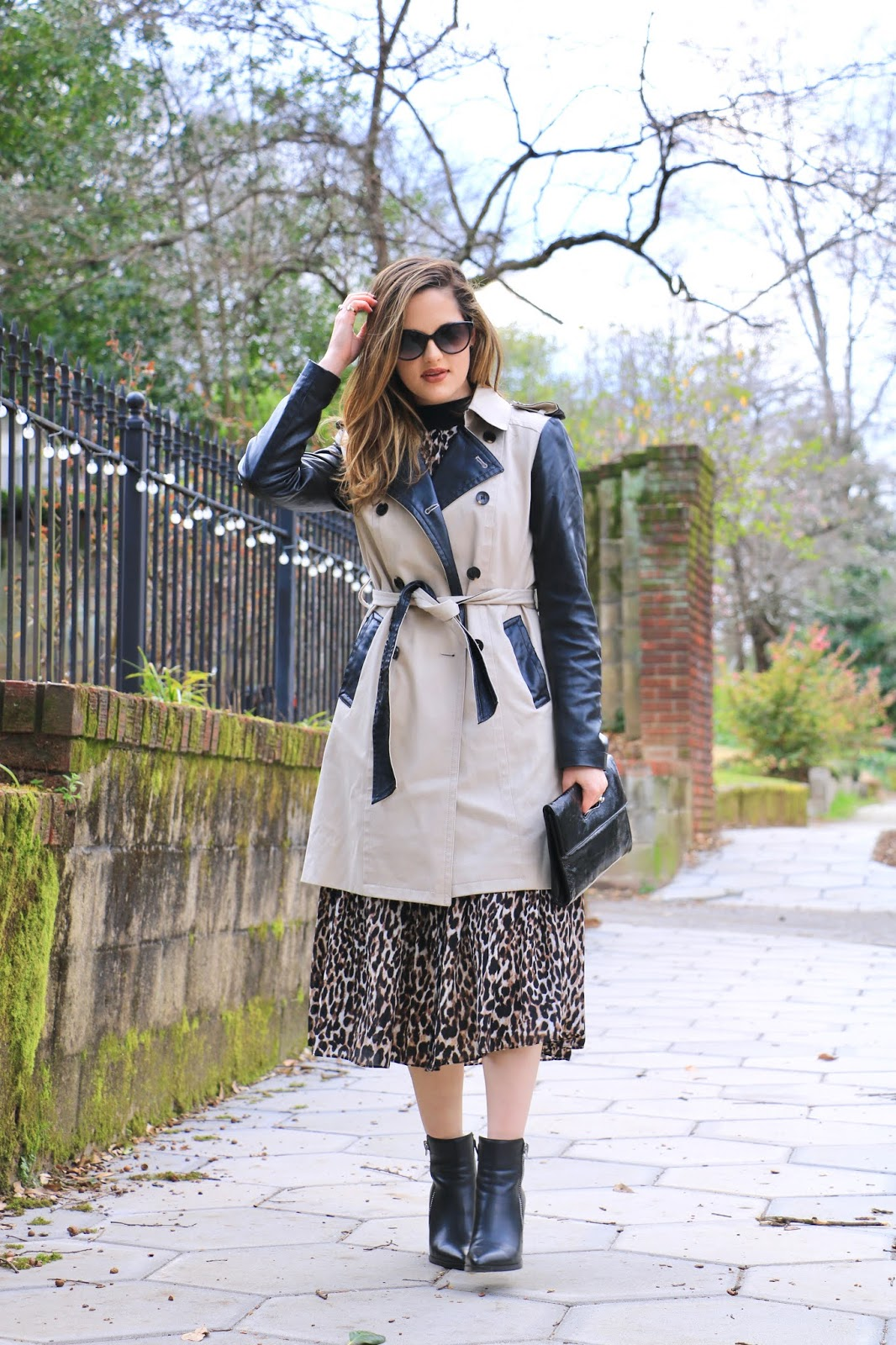 Nyc fashion blogger Kathleen Harper wearing a leopard midi dress outfit.