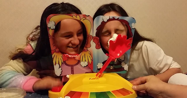My two girls playing pie face showdown