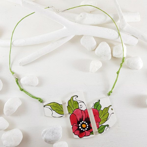 Paper necklace with tattoo-style floral pendant in red and lime green with lime green necklace cording