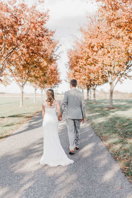 bride and groom fall trees
