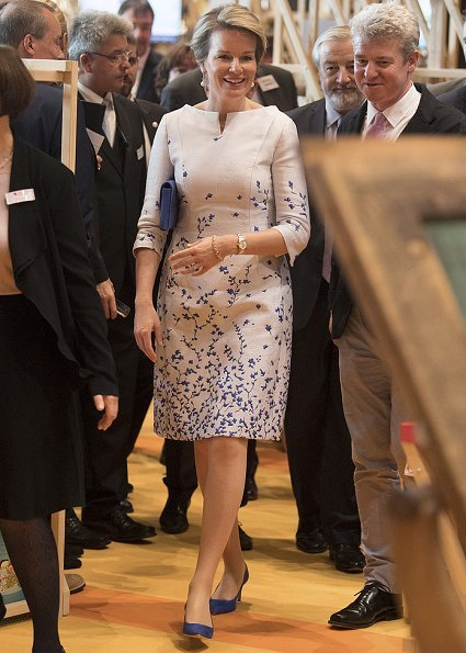 Queen Mathilde visited the Frankfurt Book Fair 2017. Queen Mathilde wore Natan dress, and Natan clutch bag