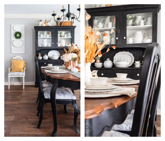 dining room with black hutch, velvet yellow pillows, white shutters, white ironstone and dried wheat
