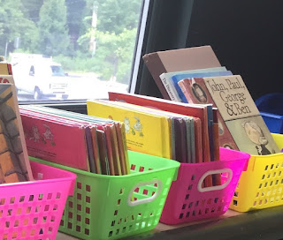 Flexible Seating Storage neon baskets with books