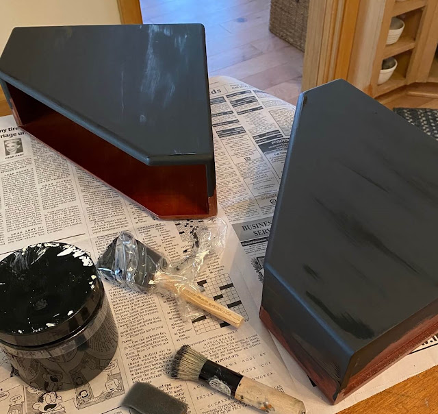 Photo of wooden file bins being painted black