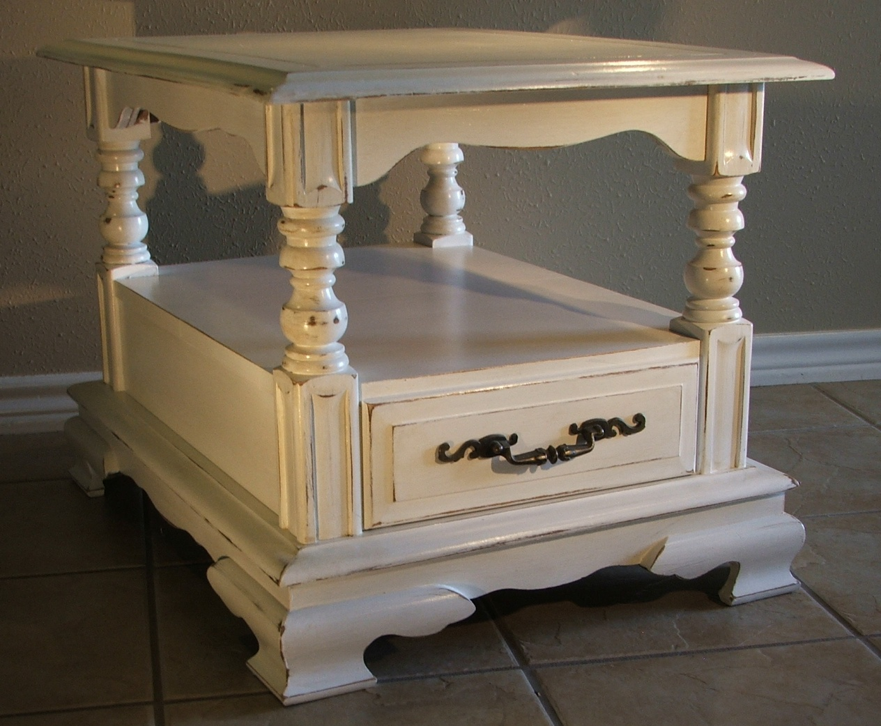 Tea-stained glaze creates a antiqued white look with lots of character–and  some real charm! 28″ long, 21″ wide, and 20″ tall. Includes original  hardware–a ... - Chunky Antiqued White End Table - Facelift Furniture