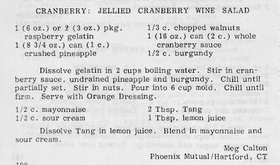 """Recipe for """"Jellied Cranberry Wine Salad,"""" made from crushed pineapple, walnuts, and whole cranberries suspended in rasberry gelatin mixed with burgundy."""