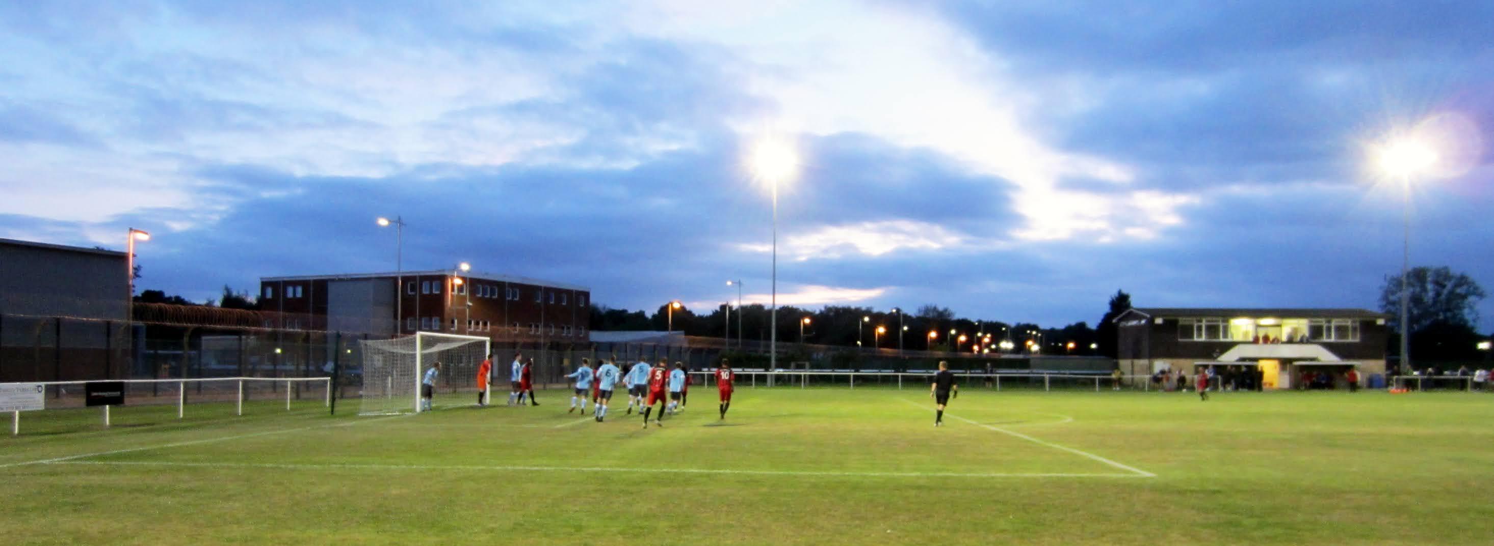 AFC Aldermaston player takes a corner kick against Woodley United