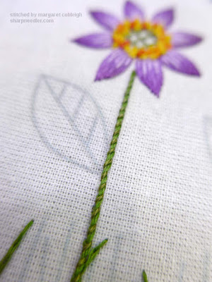 Stem of purple flower in whipped chain stitch