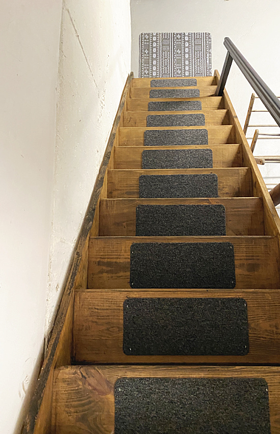 stained and painted steps with rugs