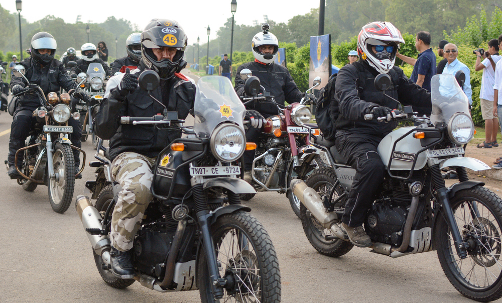 Motorcyclists in Royal Enfield Himalayan bikes arrive at India Gate in New Delhi