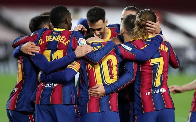 Barcelona players celebrate during a La Liga match