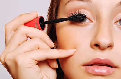 Apply mascara to the upper lashes by The Cinema Blogs
