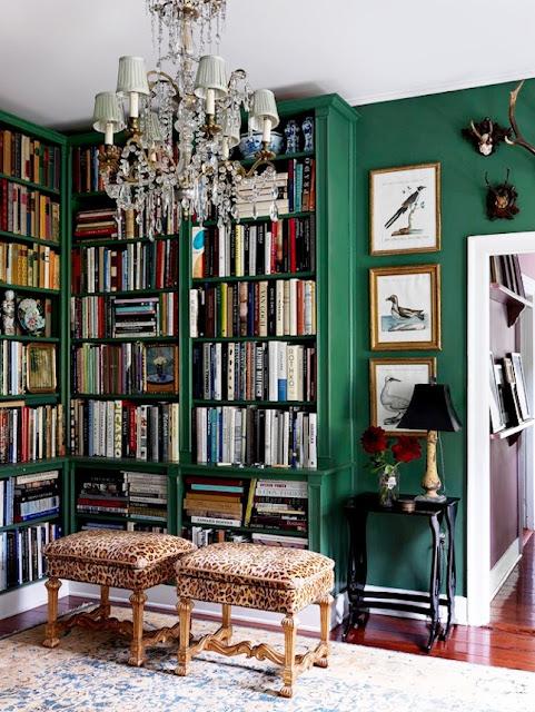 grenn bookcases and leoplard fabric on stools