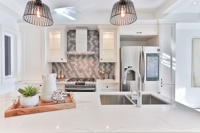 A shiny clean white kitchen from a stock image