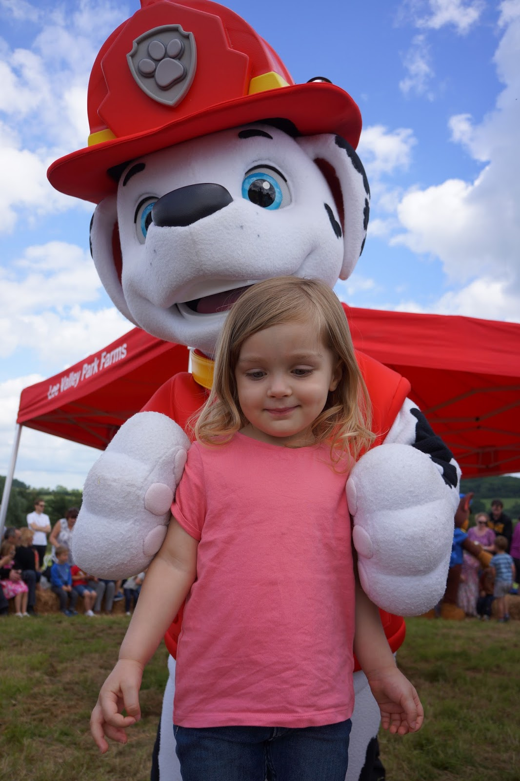 toddler in front of paw patrol marshall mascot