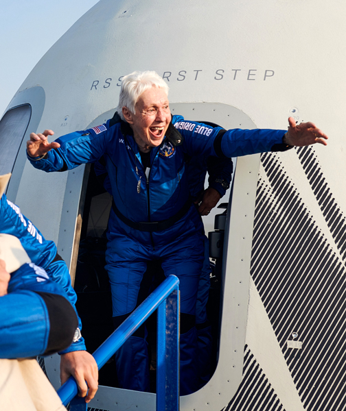Wally Funk triumphantly exits from the New Shepard capsule after making her first flight into space at the age of 82...on July 20, 2021.