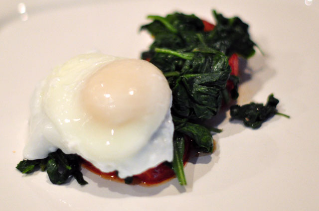 poached eggs on roasted tomatoes and spinach