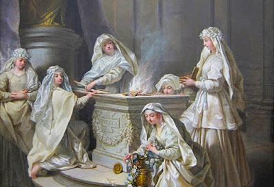 Le vergini vestali che tendono al fuoco sacro.