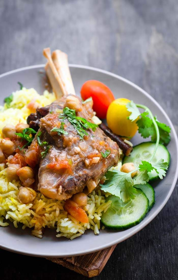 slow cooked lamb shanks on  a bed of saffron rice