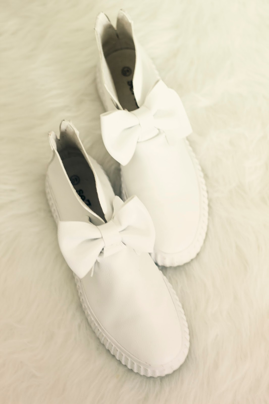 white sneakers with bow