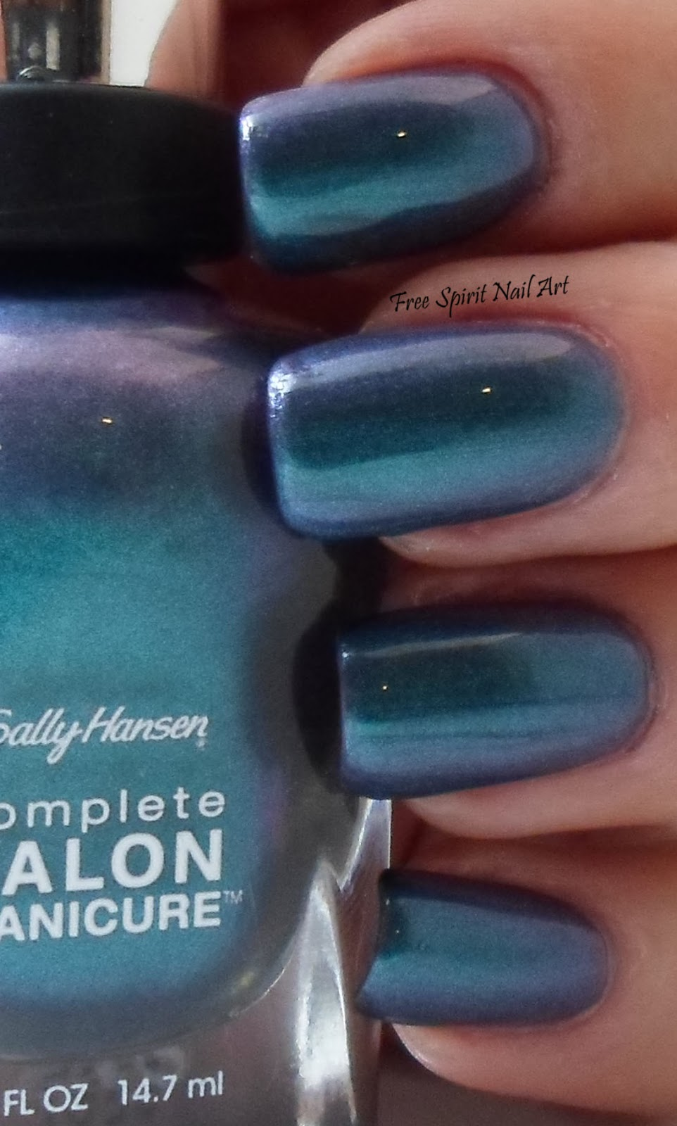 free spirit nail art: sally hansen black & blue swatch and review