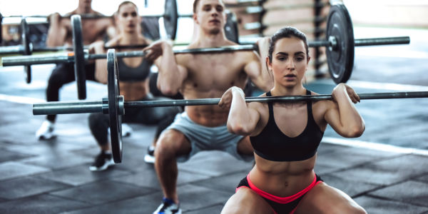 Group of Persons Workout In A Gym