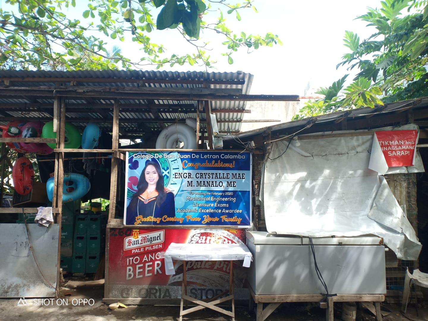Grandma proudly posts granddaughter's tarpaulin on dilapidated house